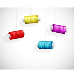 Bobbins of colorful thread vector image