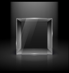 Empty glass showcase in cube form with spot light vector