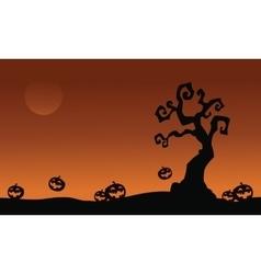 Halloween pumpkins and dry tree vector
