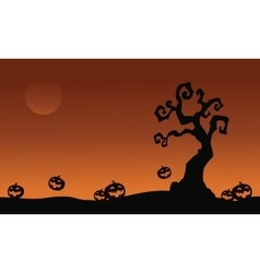 Halloween pumpkins and dry tree vector
