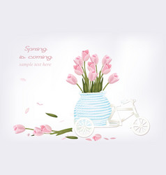 Vintage bicycle toy with tulip flowers in a basket vector