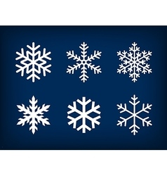 White snowflakes on dark blue background vector