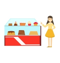 Woman standing next to display case with cake vector