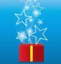 Glowing star floating from giftbox vector