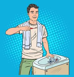 Pop art man brushing teeth in bathroom vector