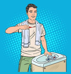 Pop art man brushing teeth in bathroom vector