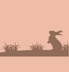 silhouette of bunny and grass landscape vector image vector image