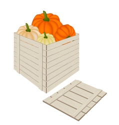 A pile of pumpkins in wooden cargo box vector