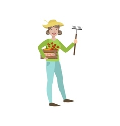 Woman farmer holding the rake and crate of vector