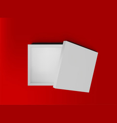 white open empty squares cardboard box on red vector image vector image