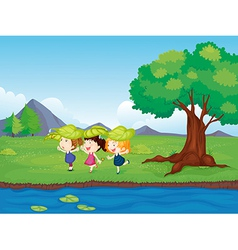 Three girls playing beside the pond vector image