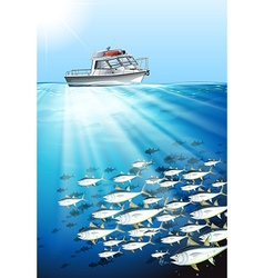 Fishing boat and fish under the sea vector