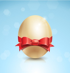 Easter egg with red bow vector