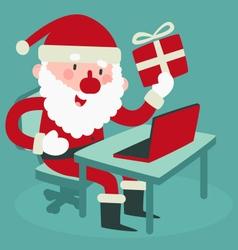 Cute Santa Holding a Gift At the Computer vector image