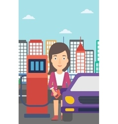 Woman filling up fuel into car vector