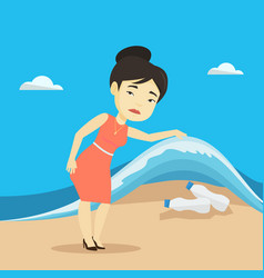 Woman showing plastic bottles under sea wave vector