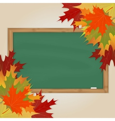 Maple leaves and green chalkboard vector