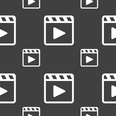 Play video icon sign seamless pattern on a gray vector