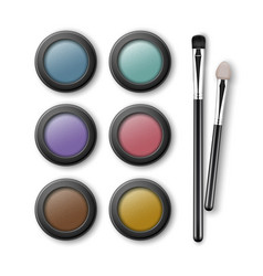 Set of multicolored eye shadows with applicators vector