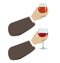 Hand with glass of wine vector