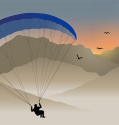 Paraglider hovers over the mountain like a bird vector