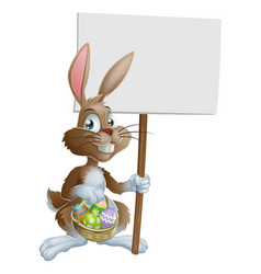 easter bunny rabbit holding sign vector image vector image