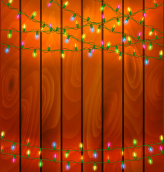 Colorful garlands on wood background vector