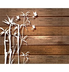 White bamboo and birds over wood background vector