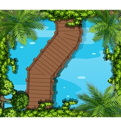 Top view of bridge and pond vector