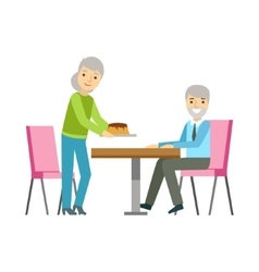 Old couple eating cake at the table smiling vector