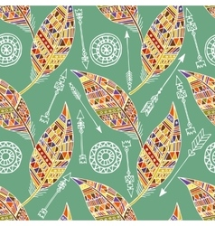 Seamless pattern with feather and arrows in vector