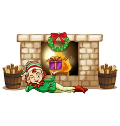 An elf in front of the fireplace vector