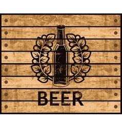 beer bottle on wooden box vector image