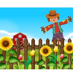 Scarecrow in the sunflower field vector