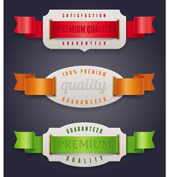 Labels of quality with color ribbon vector