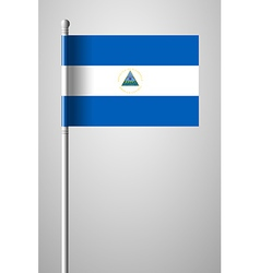 Flag of nicaragua national flag on flagpole vector