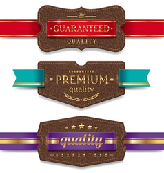 Leather quality labels with ribbon vector