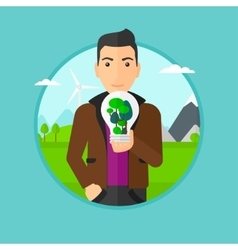 Man holding light bulb with tree inside vector