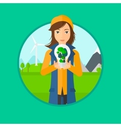 Woman holding light bulb with tree inside vector
