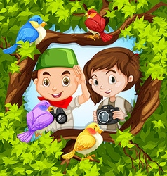 Bird watching with boy and girl vector image
