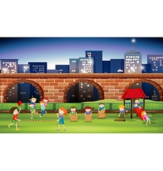Children playing in the park at night vector