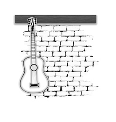 Musical instruments guitar on the brick wall vector