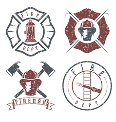 Grunge set of fire department emblems and badges vector