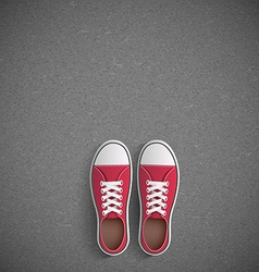 Vintage sneakers stand on asphalt vector