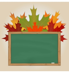 Maple leaves on green chalkboard vector