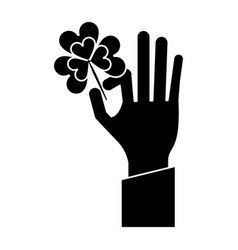 Hand holding clover st patricks day pictogram vector