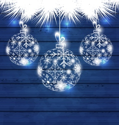 Christmas balls made in snowflakes on blue wooden vector