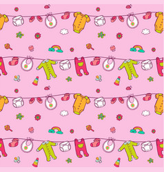Seamless pattern with cute baby clothes vector