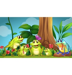 Frogs sitting on the grass vector