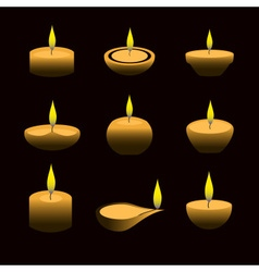Lighting wax diwali candles with flame at night vector